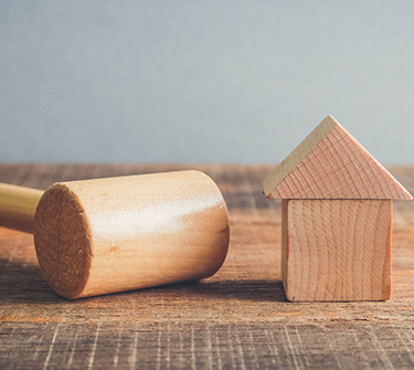 How do i buy a house at auction?