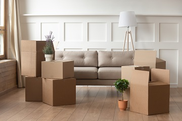 Sofa surrounded by boxes